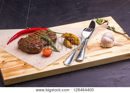 Grilled Veal Steak With Vegetables On A Plate