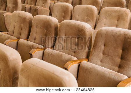 Empty brown velvet seats in auditorium for meeting