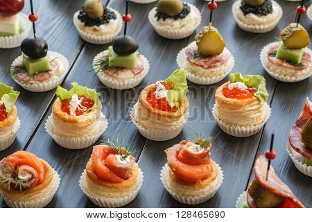Fresh Assorted snacks of canape on the table