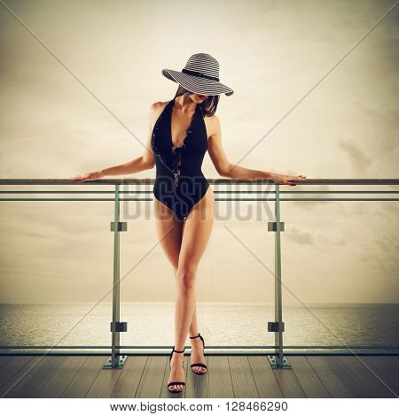 Woman leaning against a railing of cruise