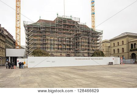 Bern, Switzerland - 19 October, 2015: the Swiss National Bank building under renovation view from Bundesplatz square. The Swiss National Bank conducts Switzerland's monetary policy as an independent central bank.