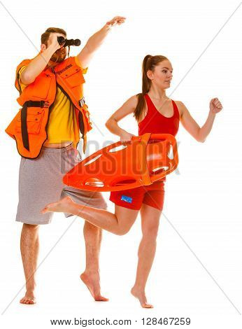 Lifeguards In Life Vest With Rescue Buoy Running