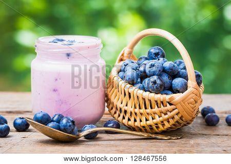 Fresh Blueberries Yogurt In Jar And Small Basket Of Bilberries.