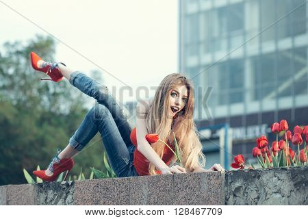 Cute Young Girl Holds The Red Tulip