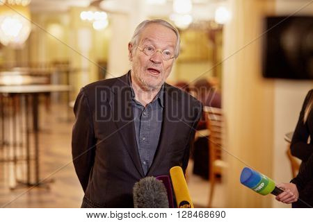 MOSCOW, RUSSIA - JAN 15, 2015: Peter Stein stage director of play Boris Godunov talk to journalists during interview after media preview  at foyer of Moscow theatre Et Cetera.