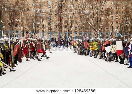 RUSSIA, MOSCOW - DEC 28, 2014: Warriors dressed in defensive equipment and spectators during historic reenactment battle on Military History maneuvers on Taganka.