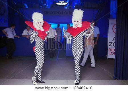RUSSIA, MOSCOW - JUN 12, 2015: Actors dressed for performance pose in front of entry to hall of Sensation Wicked Wonderland show at Olympiysky sports complex.