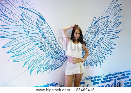 RUSSIA, MOSCOW - JUN 12, 2015: Young woman poses at Olympiysky sports complex before Sensation Wicked Wonderland show begins.