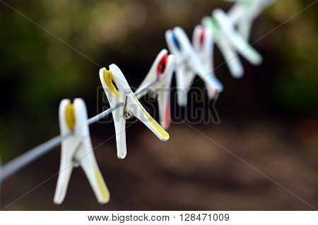 Plastic clothes pegs on a washing line