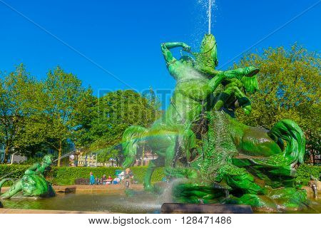 HAMBURG, GERMANY - JUNE 08, 2015: Water came out from different figures and colors, fountaine in the midle of the park in a summer day