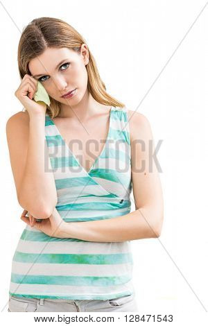 Sad woman with tissues on white background