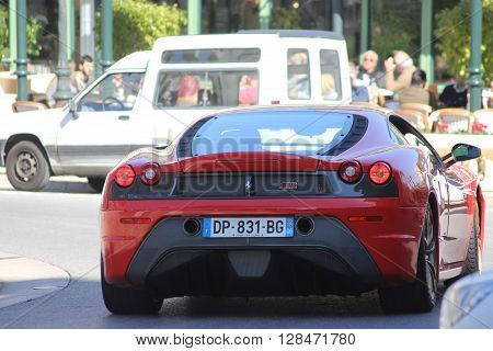 Monte-Carlo Monaco - March 9 2016: Red Ferrari 430 Scuderia (rear view) Parked in Front of the Monte-Carlo Casino in Monaco
