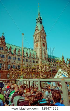 HAMBURG, GERMANY - JUNE 08, 2015: City hall view from a drop on and drop off bus, emblematic buiding. Clock in the middle,
