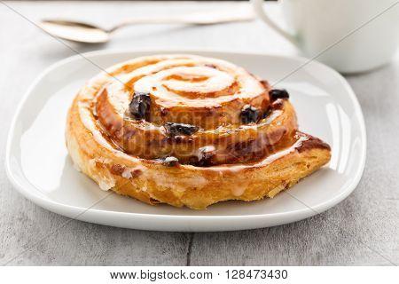 Fresh danish pastry with raisins and vanilla.