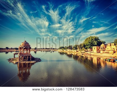 Vintage retro effect filtered hipster style image of Indian landmark Gadi Sagar - artificial lake. Jaisalmer, Rajasthan, India