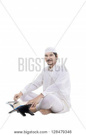 Young Asian Muslim People Reading Koran