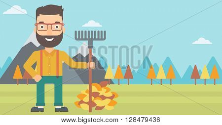 Man with rake standing near heap of autumn leaves.