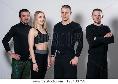Group of active young people standing in the studio