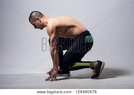 Man runner jogger running  isolated. Athlete at the start