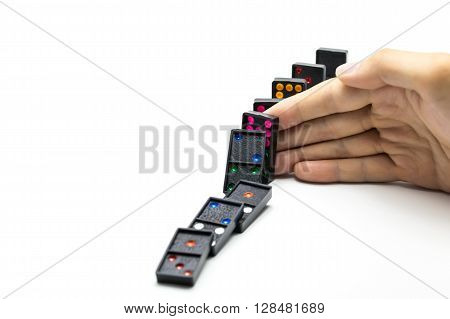 Businessman Hand Stopping Domino Effect On Isolated White Background With Copy Space - Business Solu