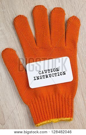 Construction protective glove and a card with the words Safety