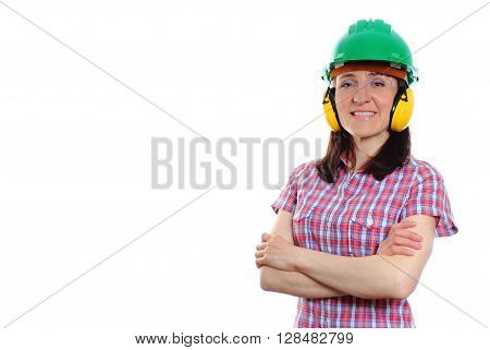 Female construction worker wearing green helmet and protective headphones safety at work and ear protection copy space for text. White background