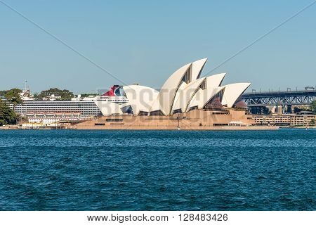 Sydney Australia - November 9 2014: The Sydney Opera with the cruise ship and the Harbor Bridge in the background Sydney New South Wales Australia.