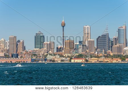 Sydney Australia - November 9 2014: Australian Sydney landmark - city CBD high rises and towers forming megapolis cityscape summer day from harbour Sydney NSW Australia.