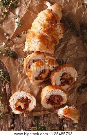 Chicken Roll With Cheese And Sundried Tomatoes Close-up. Vertical Top View