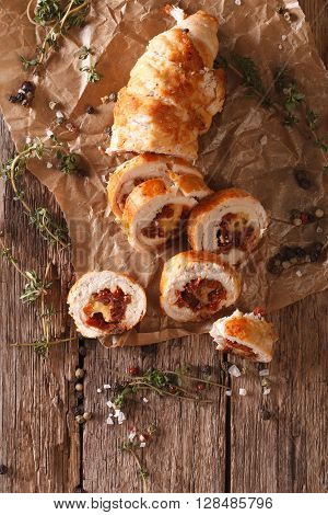 Chicken Roll Stuffed With Cheese And Sun-dried Tomatoes Close-up. Vertical Top View