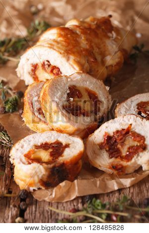 Chicken Roll With Cheese And Sundried Tomatoes Close-up. Vertical, Country
