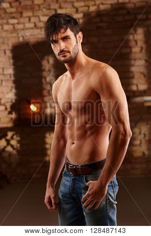 Sexy photo of handsome young man with bare upper body.