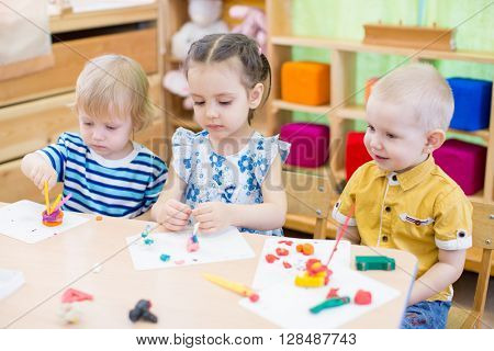 kids learning arts and crafts in kindergarten