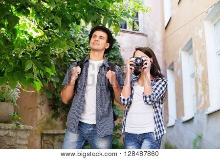Young couple making photos as tourists.