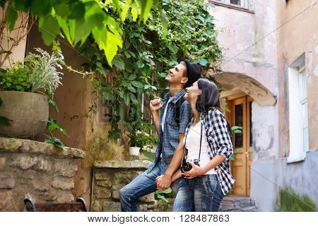 Young couple being tourists exploring an old town.