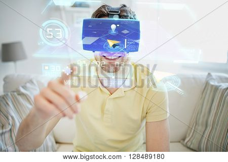 technology, gaming, entertainment and people concept - happy young man in virtual reality headset or 3d glasses with gps navigator map at home