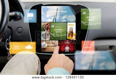 transport, driving, technology, media and people concept - close up of male hand using virtual internet applications on car computer screen
