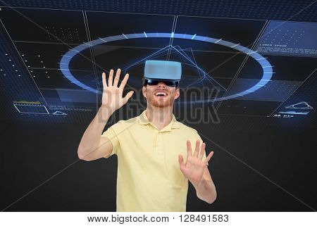 3d technology, virtual reality, entertainment and people concept - happy young man in virtual reality headset or 3d glasses playing game over black background with screens