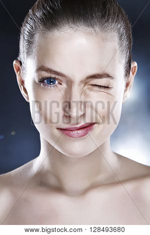 Portrait of a beautiful woman with one eye closed