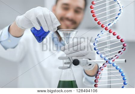 science, chemistry, biology, medicine and people concept - close up of scientist filling test tubes with funnel and making research in clinical laboratory