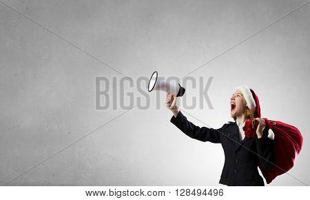 Santa announcing something in megaphone