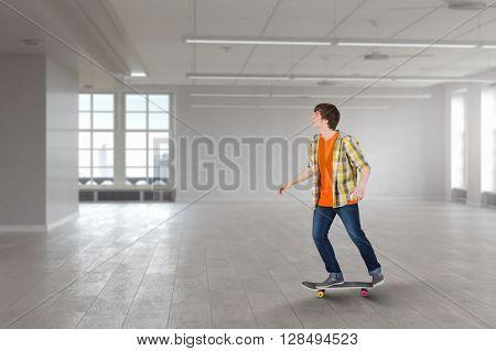 Skateboarder guy in interior