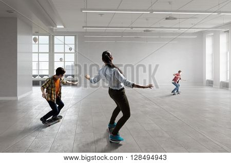 Young people ride skateboard