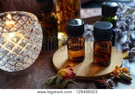 essential oils for aromatherapy treatment in candle light