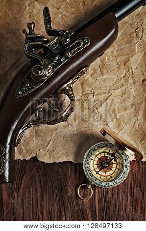 Ancient Pistol And Brass Compass