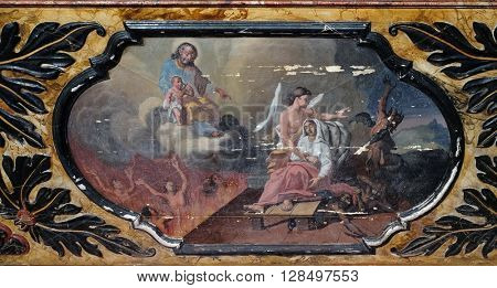 KOTARI, CROATIA - SEPTEMBER 16: The angel and the devil fight for the soul of the dying, altarpiece in the church of Saint Leonard of Noblac in Kotari, Croatia on September 16, 2015.