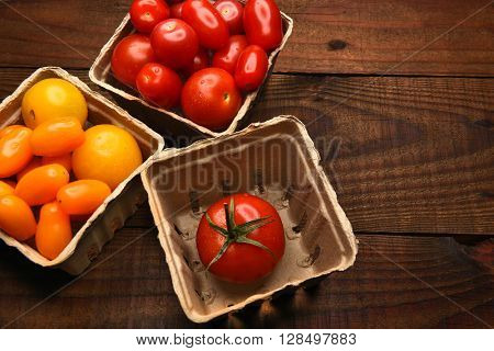 Top view of produce baskets filled with a variety of medley tomatoes. Horizontal format with copy space.