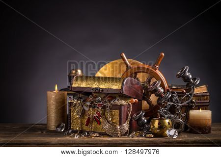 Old wooden chest with golden jewelry, studio shot