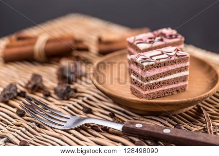 Decorative layered desserts on white plate, studio shot