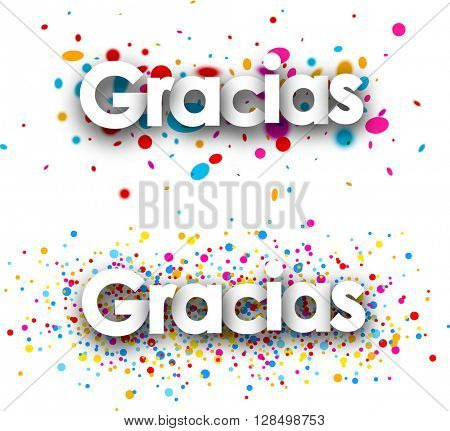 Thanks paper banners set with color drops, Spanish. Vector illustration.